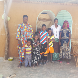 Mr. Bonkoungou and his family in front of their NV house